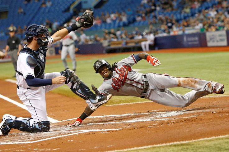 Rays shutout the Braves -  Tampa Bay Rays catcher Curt Casali gets the out at home plate on Cameron Maybin of the Atlanta Braves during a game on Aug. 11 in St. Petersburg, Florida. The Rays won 2-0. - © Brian Blanco/Getty Images