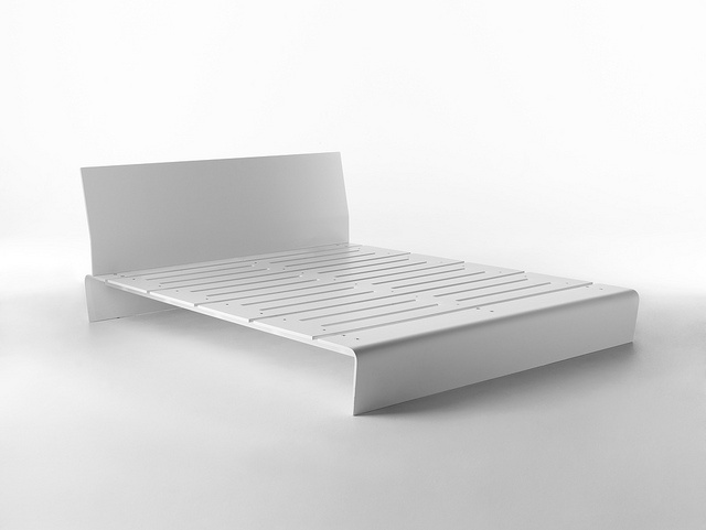 Hi-Ply / Design: StH, 2011 / The aesthetic and functional balance results in the sinuous lines of the Hi-Ply bed. The plywood legs complete the continuity of the bedsprings with elegant yet hard curves where the horizontally cut slats highlight its lightness.