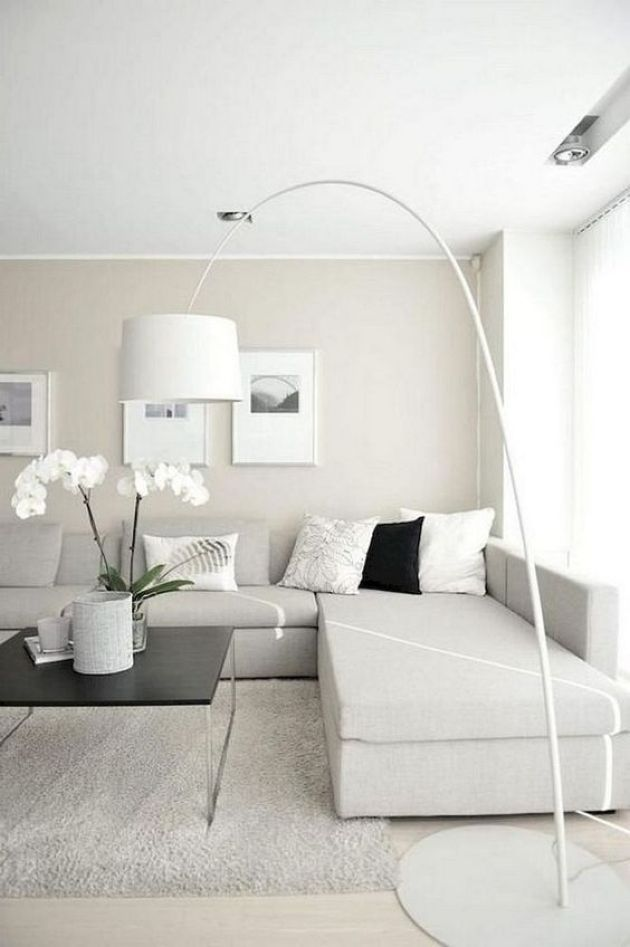Neutral Minimalist Living Room With An Off White Sectional Sofa Beige Living Rooms Minimalist Living Room Design Minimalist Living Room