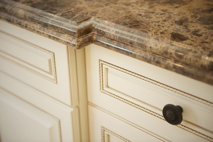 emperador dark marble countertops with antique white cabinets