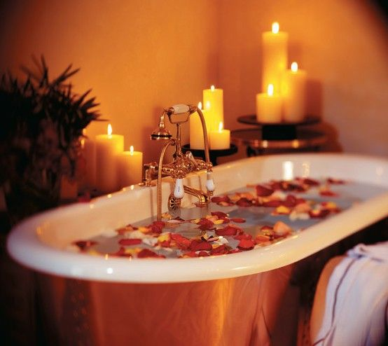 rose petals in a hot bath with candles
