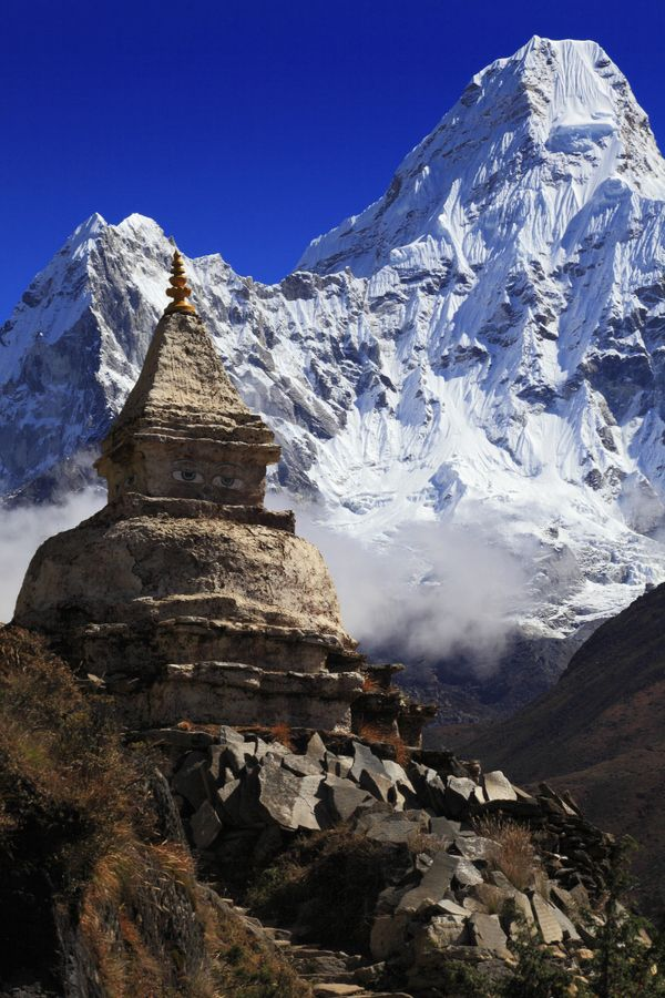 Stupa with Buddha Eyes, Ama Dablam (6,812m) in the background -  Sagarmatha National Park, Khumjung, Nepal