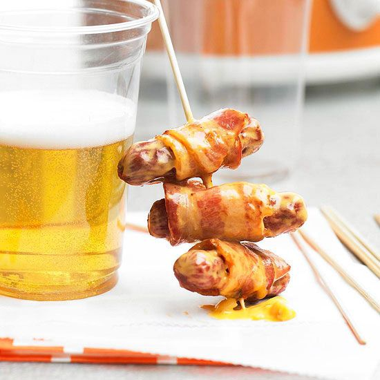 These bacon and cheese wrapped weenies flavored with beer make for the perfect game day snack. More game day recipes: http://www.bhg.com/recipes/party/party-ideas/football-party-recipes/?socsrc=bhgpin031613cheddarweenies
