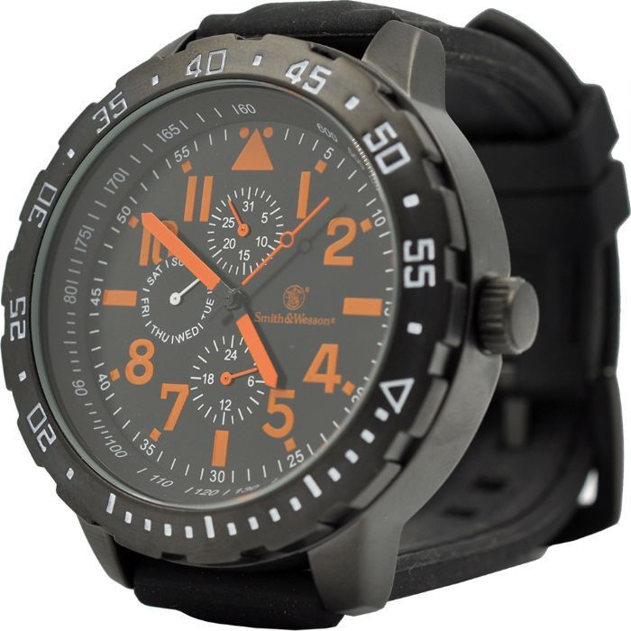Slide your hand into the bold style and sophistication of the Smith & Wesson Calibrator Watch that features a round black face with large orange numbers and hands and black rubber wristband. Crafted w