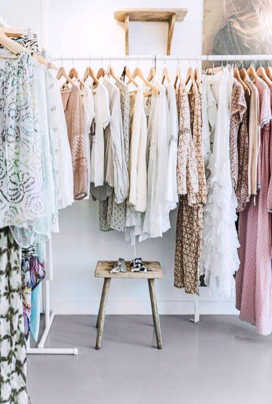 white clothing racks with wood stool and shelf / @sfgirlbybay