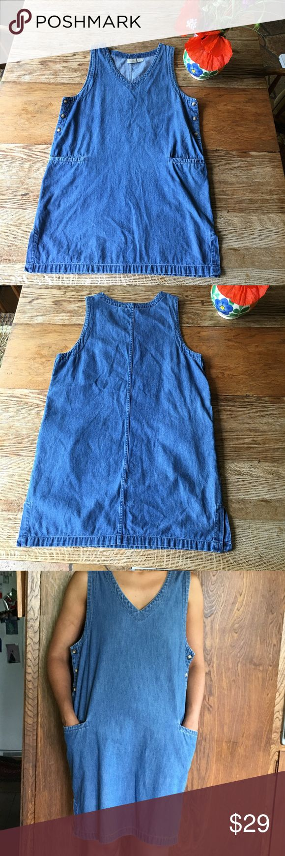 """% Cotton Sweet Jean Dress Vintage, sweet and soft Jean dress. In great shape with v-neck, waist pockets and side buttons. Size large. Modeled on size 4/6*** Approximately 34"""" from shoulder to hem. 100% cotton. Dresses"""