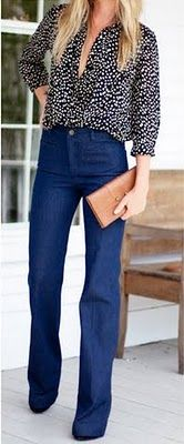 legs for days in perfectly tailored high waisted jeans with tucked flowing floral