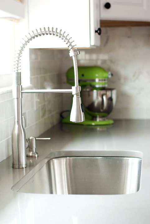 Grey Expo Silestone countertops, faucet from Lowe's