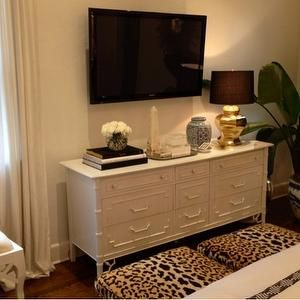 master bedroom dresser with tv above gives us extra clothes storage