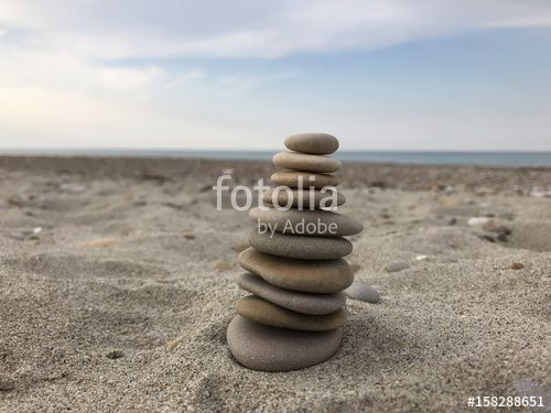 """Download the royalty-free photo """"Stack of pebbles, relaxing conceptual game"""" created by Ciaobucarest at the lowest price on Fotolia.com. Browse our cheap image bank online to find the perfect stock photo for your marketing projects!"""