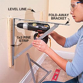 Fold away brackets for laundry room folding table.