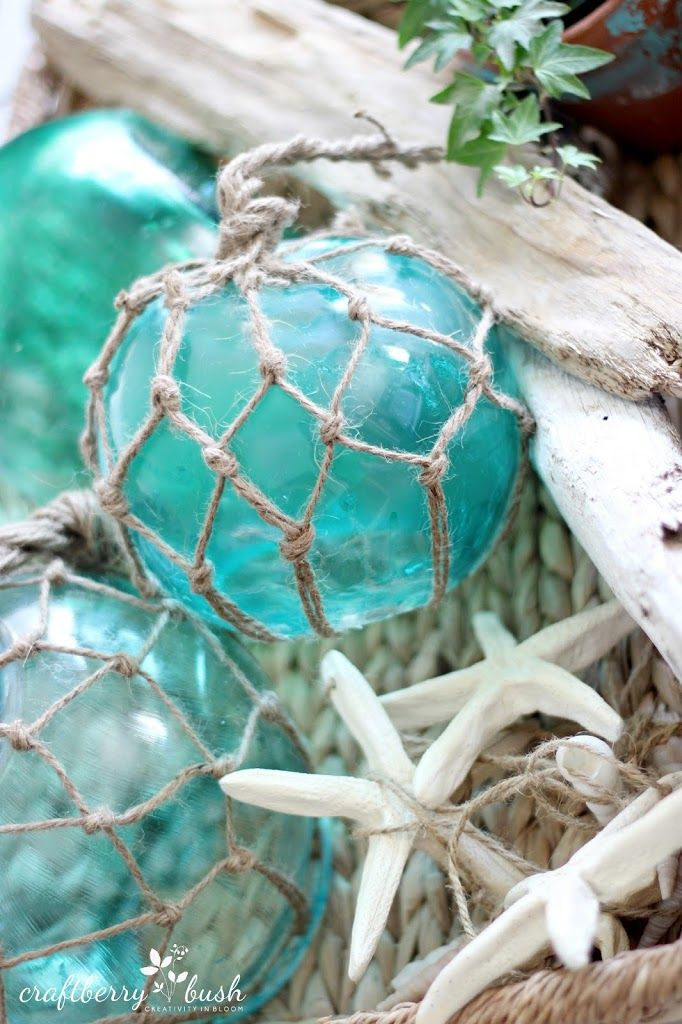 DIY: How to Make Pottery Barn Inspired Large Glass Buoys - using round thrifted bowls (she shows you how to paint them) + How to Tye the Netting using Jute - via Craftberry Bush