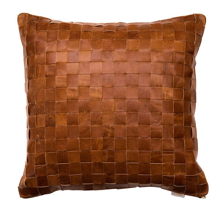 The ultimate luxury accessory this season is the Elson leather woven cushions…