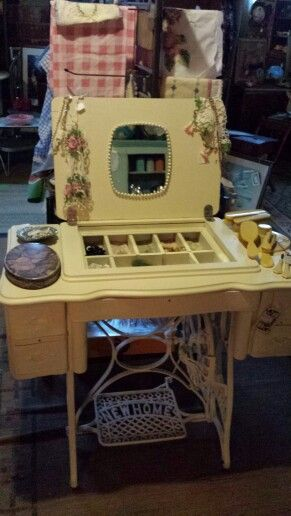 Vintage treadle sewing machine repurposed into a vanity.