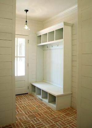 Basket weave brick floor, white plank wall mudroom by sally