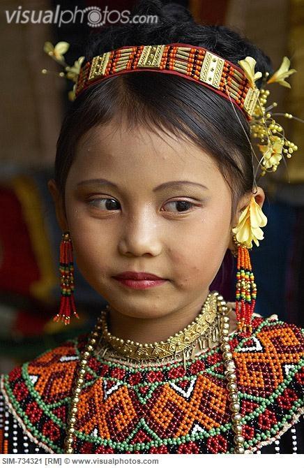 Indonesia, Sulawesi, Tana Toraja, Toraja funeral ceremony, Torajan child with traditional dress