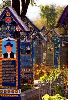 "Northern Romania - Called ""Merry Cemetery"" - Each intricately painted headstone features the deceased person's vice in life."