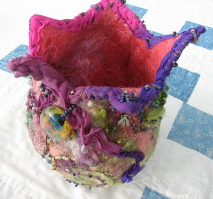 Wet-felted vessel embellished with beading and embroidery.  From Calamity Kim blog