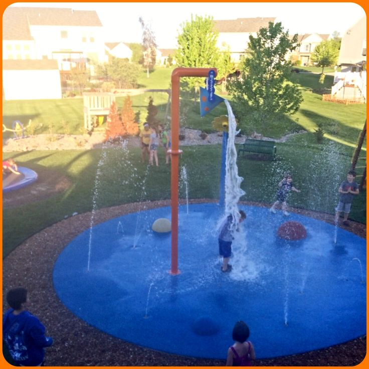 Hands down the best backyard for any child. In ground trampoline, Swing set, Big tractor tire, and this residential splash pad. Their children were getting older so they had us add a Bucket Dump to their splash pad that we installed a few years ago.
