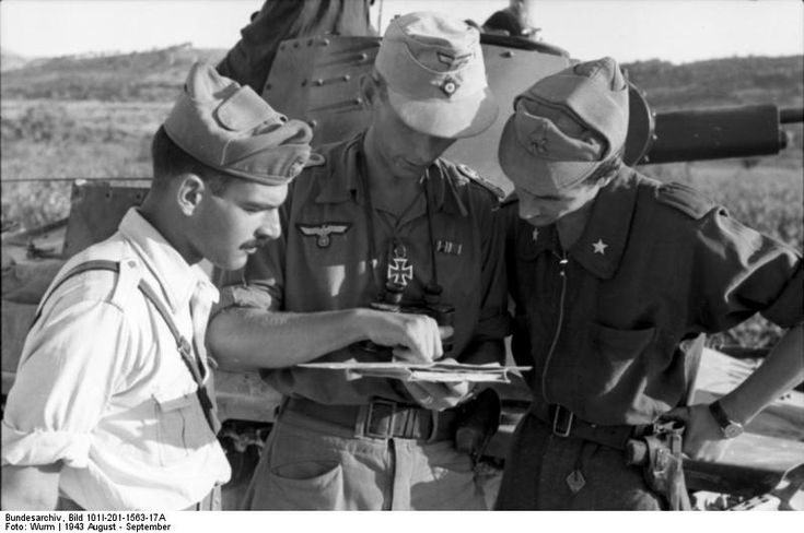 Italian and German officers in the Balkans. In the background, an Italian Fiat L6/40 Tank. Pin by Paolo Marzioli