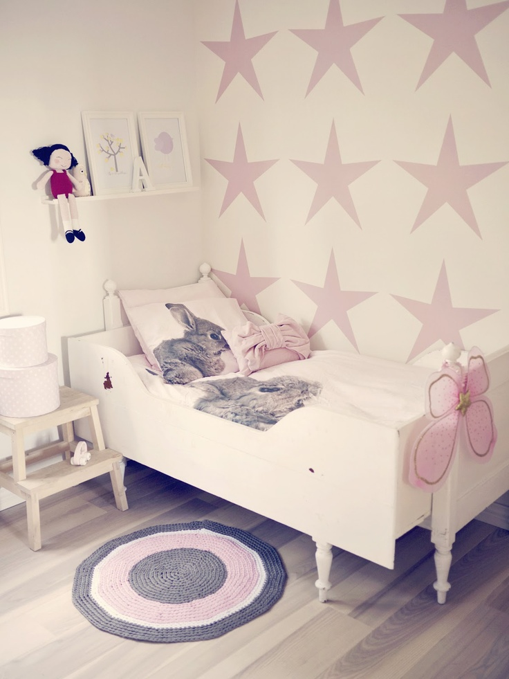 Girly room with pink stars on the wall