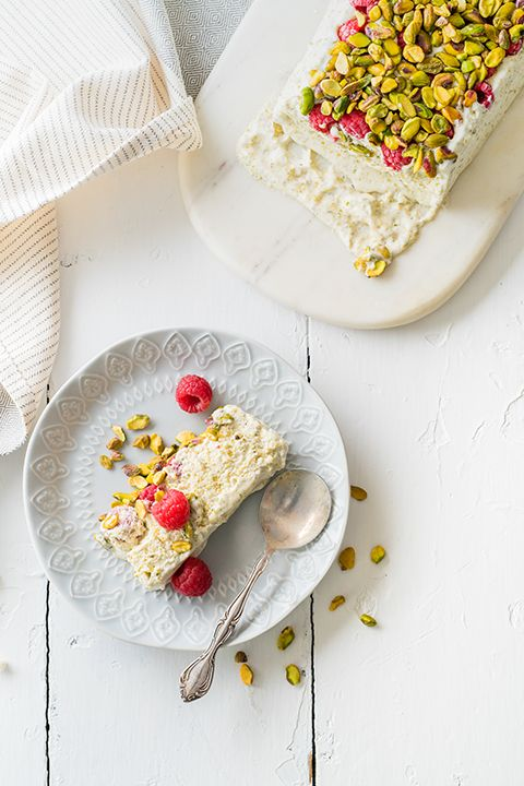 "INGREDIENTS BY SAPUTO | Semi freddo, meaning ""semi-cold,"" is a classic Italian recipe. Elegant, creamy and light all at the same time, this ice cream-style cake is a blend of whipped cream, sugar and eggs topped with pistachios and fresh fruit such as raspberries. Easy to prepare, this sophisticated dessert idea takes just 30 minutes!"