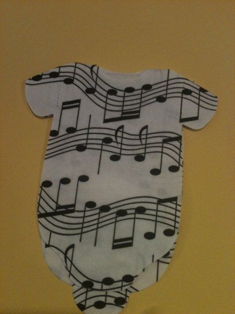Pack of 30 Baby shower shirt shaped napkins or banner decoration with musical notes.