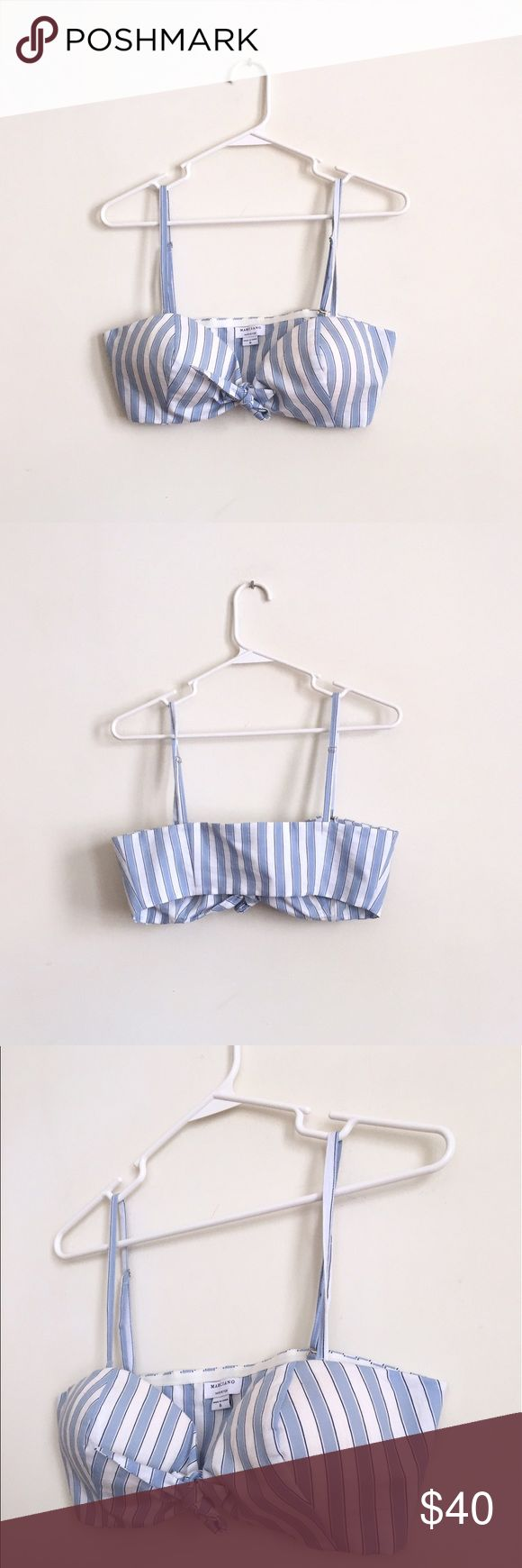 Marciano Native Fox Striped Vintage Style Bustier So adorable! This bustier/crop top channels all of our favorite vintage looks from the 60s. Striped blue and white top with mini dark blue pinstripes and a tie front, that actually opens and actually ties. Cup inserts for extra support that cannot be removed, unless of course you cut them out. Removable straps with rubber lining in back for support. Size 6, fits true to size. Probably a cotton/polyester blend. Could also be worn as a bra…