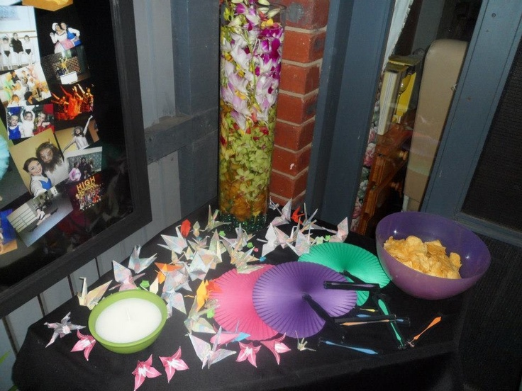 The colours in the origami, paper fans and orchids reflected the bright colours.