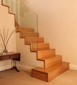 Solid Oak Cut String Staircase with Glass Balustrading.