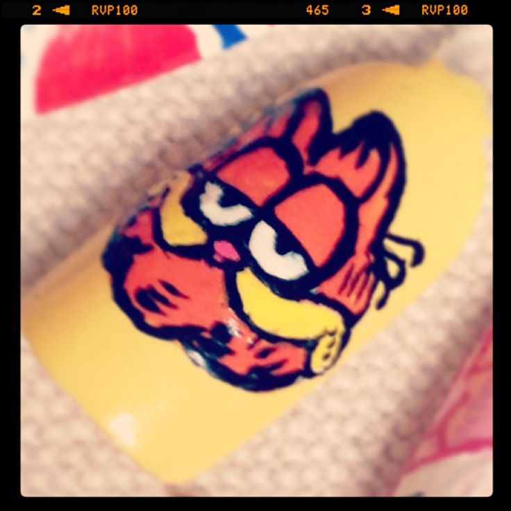 "Inspired by Garfield"" nail art Freehand done using Acrylic paint"