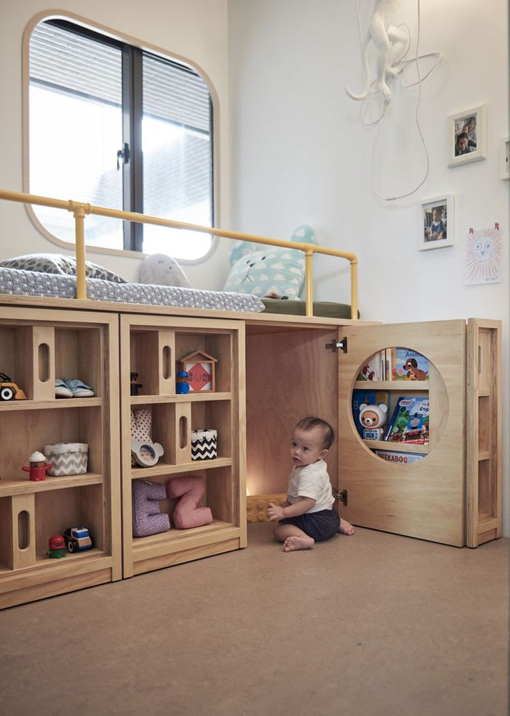 Design Detail – This Children's Bedroom Has A Custom Bed Unit With Storage And A Hidden Play Space