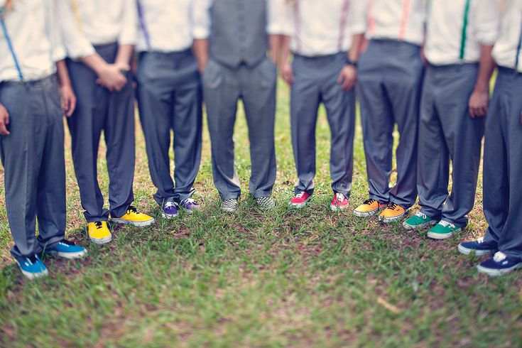 The seven groomsmen wore rainbow-hued shoes and suspenders