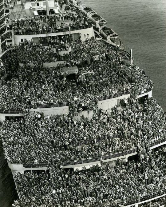 """The liner """"Queen Elizabeth"""" bringing American troops into NY Harbor at the end of WWII, 1945"""