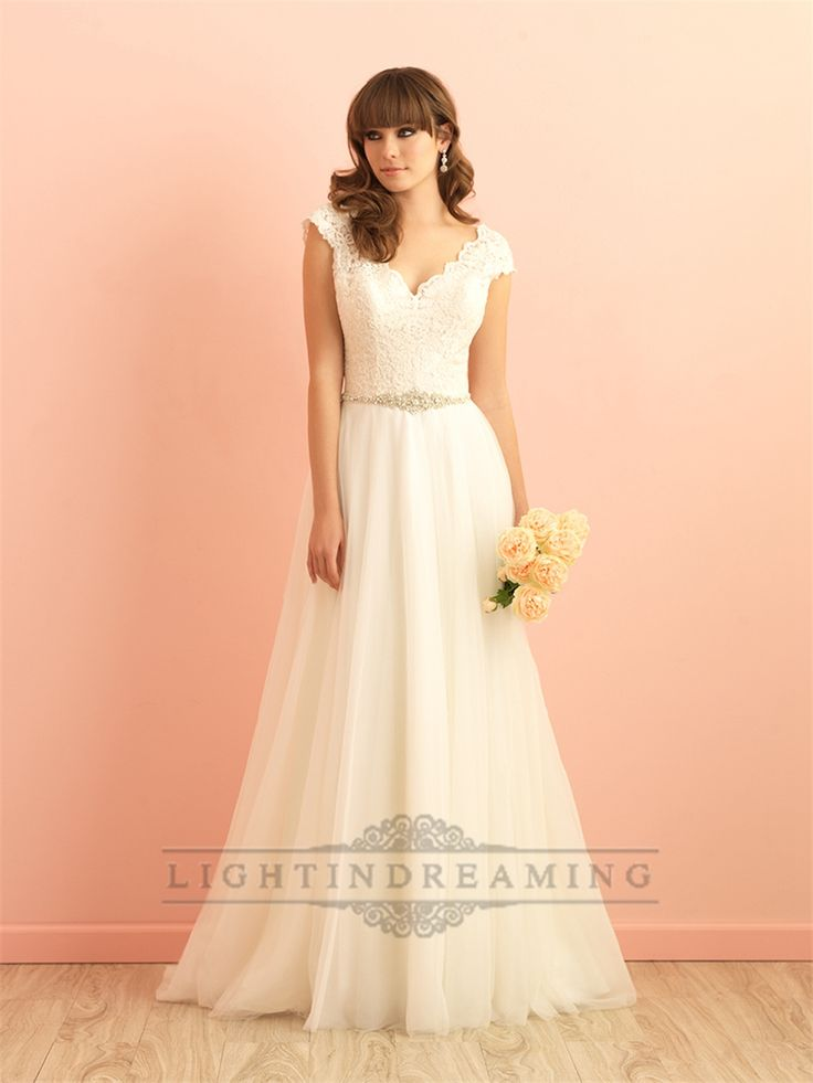 Dream a little dream of this lace-capped A-line dress. It's perfect for the fairytale-inclined bride.