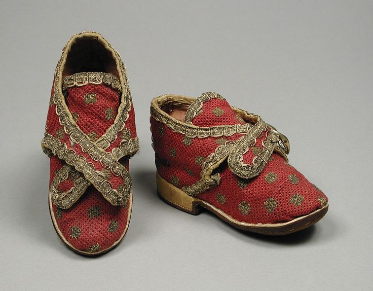 Pair of cherry red child's shoes of linen, silk, & metallic thread, is sure to bring a smile. They are most likely French, c.1730s. The petite shoes have a leather sole and measure 4 3/4 x 2 1/2 in. (12.07 x 6.35 cm) each. @LACMA