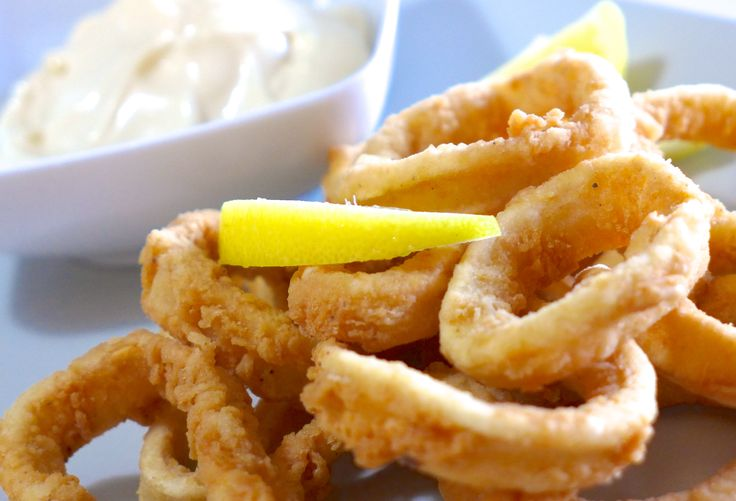 Crispy and perfectly seasoned fried calamari (kalamarakia tiganita) recipe! A favorite Greek meze that is served in every fish tavern (Psarotaverna) and you should really give it a try making it at home. Discover all the secrets behind this traditional delight here.