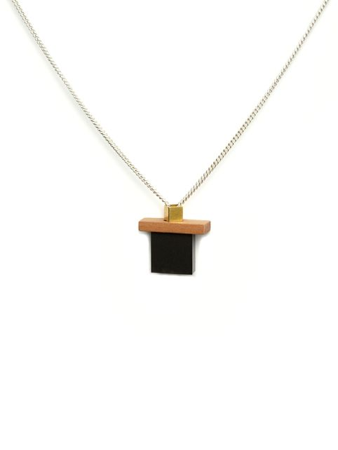 TURINA- PLAY-2.1B Sterling silver necklace (925) with pear wood, gold-plated brass and frosted acrylic glass. 45€ via turinajewellery.com