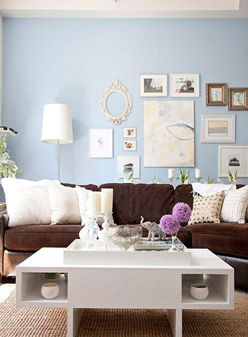 Brown couch, blue walls