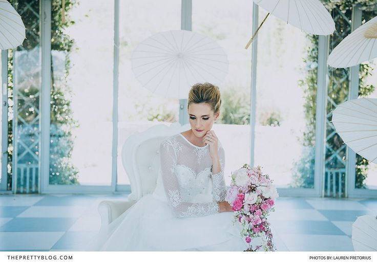 Lace sleeves, like those on this couture wedding gown, are timeless and feminine details that have stolen the hearts of countless brides. | Photographer: Lauren Pretorius Photography | Wedding Dress Designer: Stephen van Eeden | Florist: Epanouir Flower Studio