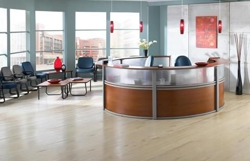 This office area is highlighted with #ModernFurniture by OFM including a curved Marque series reception desk.