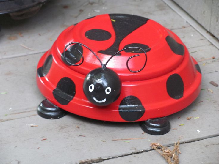 LADY BUG OUT OF CLAY SAUCERS MADE BY ANGELA.