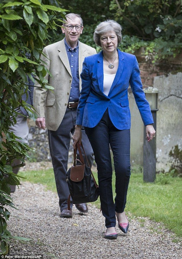 Theresa May (pictured with her husband walking behind her) took a break from her whirlwind start to her new job as Prime Minister to attend her weekly Sunday church service this morning
