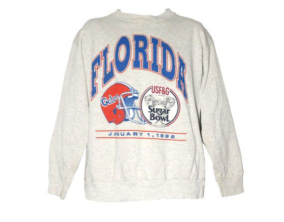 Vintage University of Florida Gators Football Crewneck Sweatshirt Adult Size Extra Large XL  Please message me with any questions!  ..::HISTORY::..  The Florida Gators are the intercollegiate sports teams that represent the University of Florida located in Gainesville, Florida. The University of Florida, its athletic program, its alumni, and its sports fans are often collectively referred to as the Gator Nation. The Gators compete in the National Collegiate Athletic Association (NCAA) and…