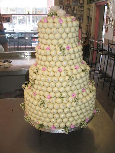 Very Cool Cake!   Four Tier Lindt LINDOR Truffle Wedding Cake with Soft Pink Roses & Wax Flowers   @Charly's Bakery