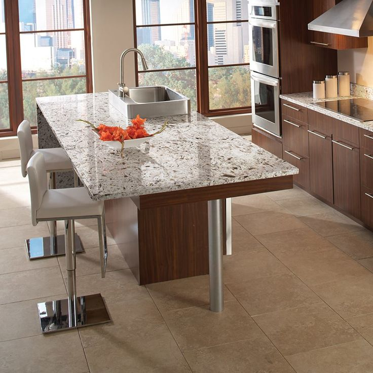 Kitchen With Beautiful Silestone Countertops  Http://www.CabinetsAndDesigns.net/products
