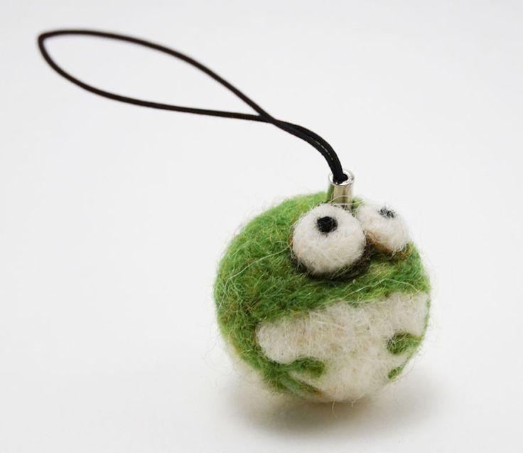 This handmade needle felted mini frog Woolbuddy is made with 100% natural wool. WoolBuddy is a collection of unique characters who come to life through the art of needle felting. The WoolBuddy collect