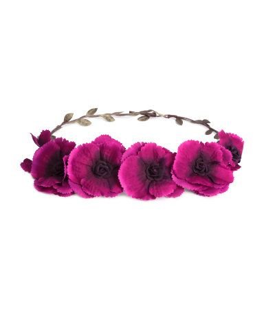 Hair decoration with fabric flowers and leaves attached to plastic-coated metal wire.