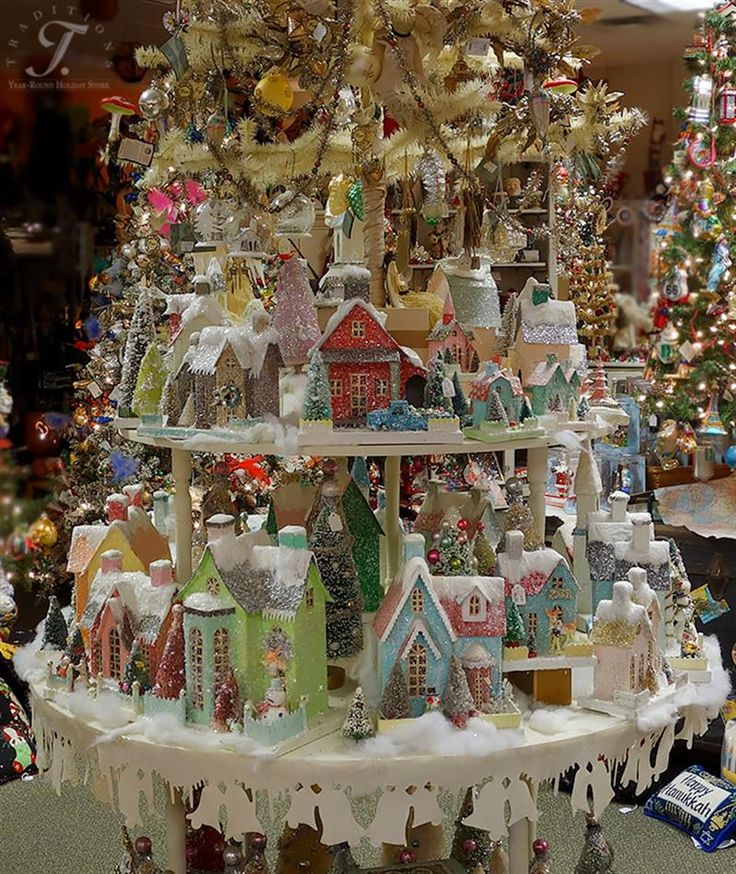 Cody Foster Tree Display  Cody's houses just make me drool and sigh...they are so beautiful and his store is @ http://www.traditionsholidaystore.com/Folk-Artists/Cody-Foster.htm