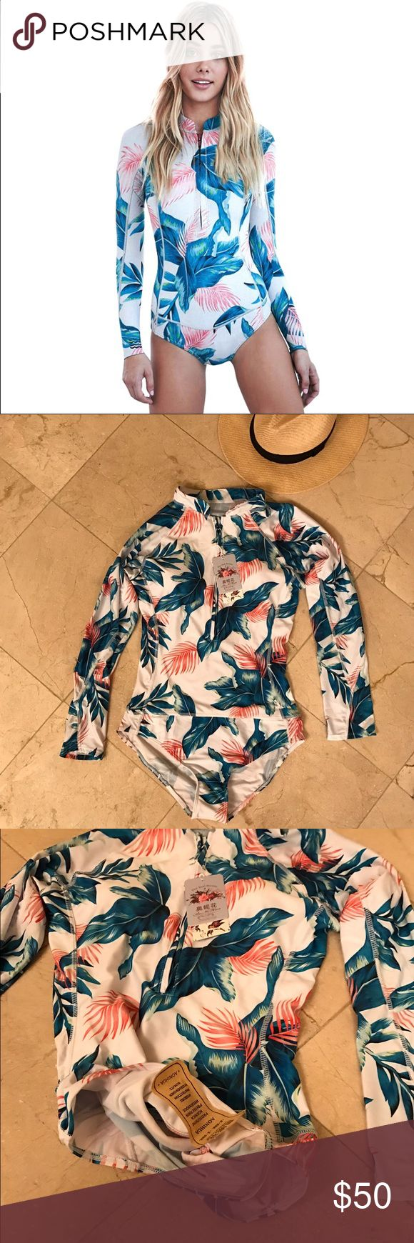 One piece swim suit with long sleeves Brand new ! With tags ! Floral swimsuit. On the tag size L (4) but I thinks it will fit M and L . I can't model because it's not my size I'm XS/S Swim One Pieces